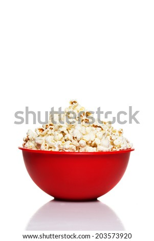 Red bowl with popcorn isolated on white - stock photo