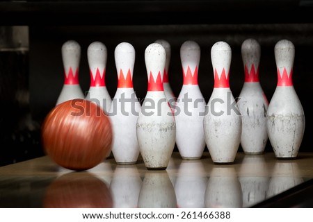Red bowling ball flying in bowling - stock photo