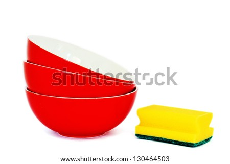 Red bowls and sponge on the white background