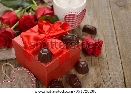Red box and chocolates on a wooden background, Valentine's Day concept - stock photo