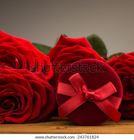 Red box gift with red rose flowers - stock photo