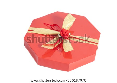 Red Box with candies and gold ribbon bow isolated on white background - stock photo