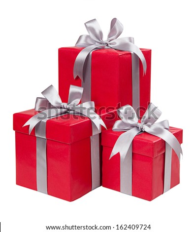 Red boxes with gifts tied with gray bows isolated on white background - stock photo