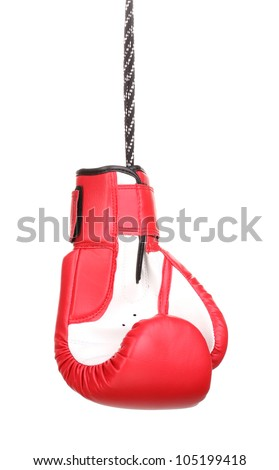 Red boxing glove hanging isolated on white - stock photo