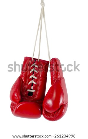 Red boxing gloves hanging isolated on white - stock photo