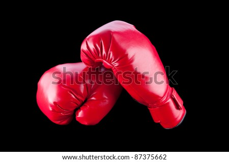 Red boxing gloves isolated on black - stock photo
