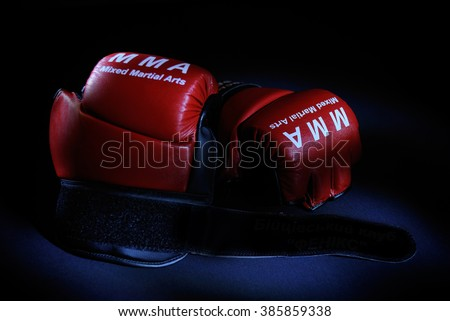 Red boxing gloves on black background. MMA mixed martial arts - stock photo