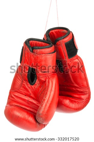 Red boxing gloves on isolated white background - stock photo