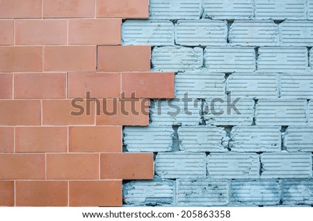 Red brick and gray empty cement wall background - stock photo
