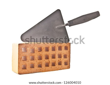 red brick and trowel, photo on the white background - stock photo