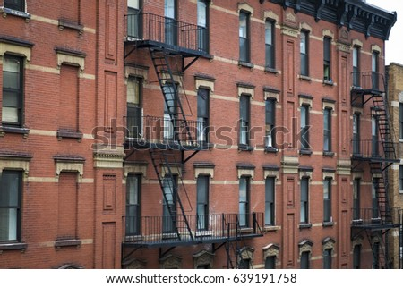 Brick Apartment Building old apartment buildings fire escapes new stock photo 134322047