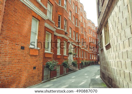 Red Brick Building In An Empty Street London City Center