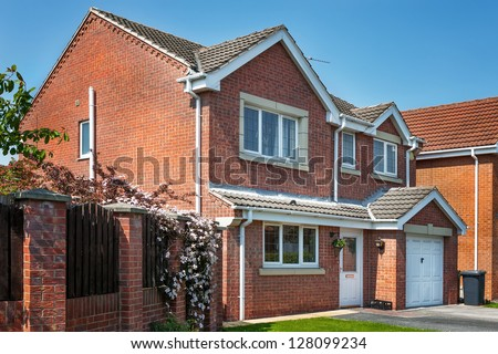 Red brick house - stock photo