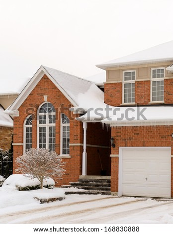 Red brick house after an ice storm