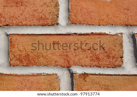 Red brick in wall - stock photo