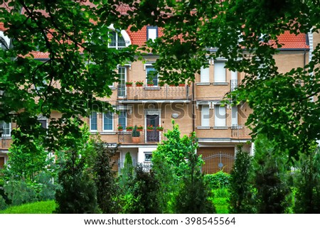 Red Brick Mansion - respectable housing, townhouse, British-style mansion with a garden. - stock photo