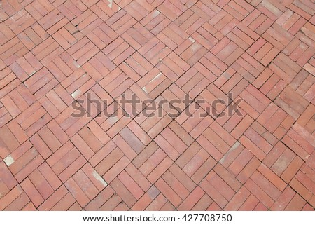 Red brick paving stones on a sidewalk