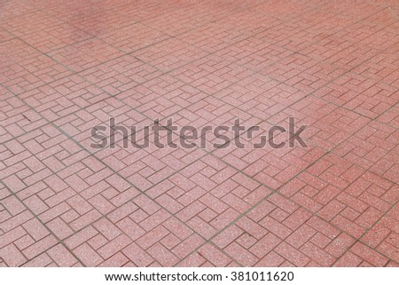 Red brick paving stones on a sidewalk background