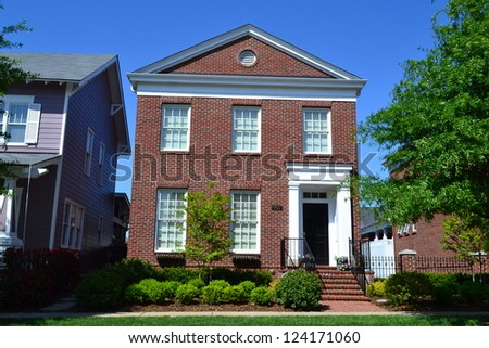 Red Brick Suburban New England Style American Dream Home - stock photo