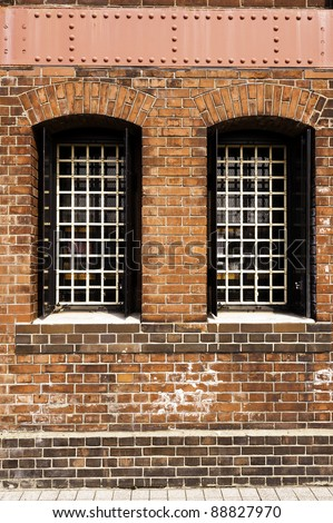 Red brick wall and window - stock photo