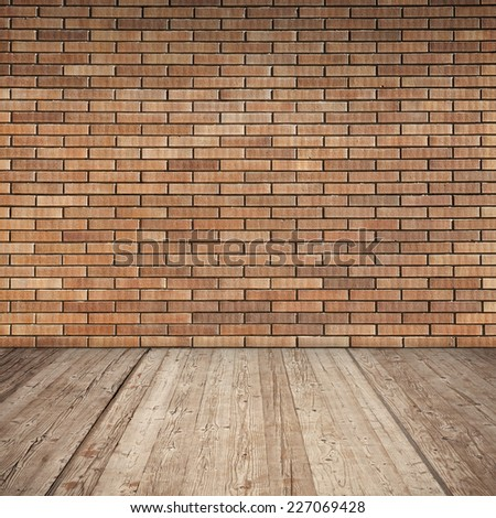 Red brick wall and wooden floor, detailed empty interior background texture - stock photo