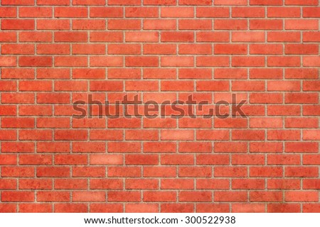 Red brick wall as a nicely textured background - stock photo