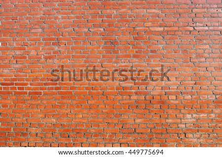 Red brick wall as background. Front view. - stock photo
