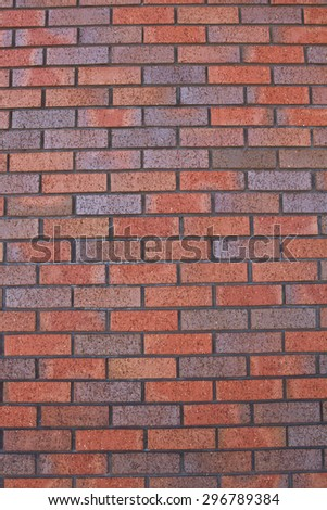 Red brick wall background vertical - stock photo