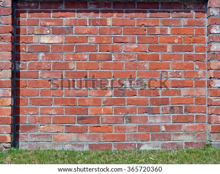 Red Brick wall background with lots of character. Ideal urban modeling background for fashion or pop music industry. Also ideal background for sign; poster or street name. - stock photo