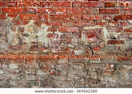 Red brick wall background with spots of concrete. Copyspace. Place for inscription. - stock photo