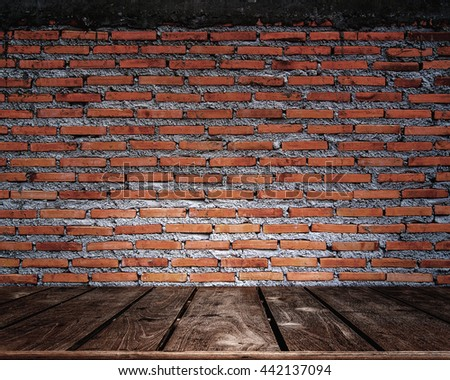 Red brick wall background with wood floor vintage tone - stock photo