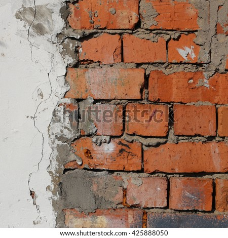 red brick wall texture  and white cracked plaster
