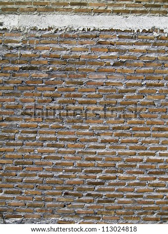Red Brick Wall Texture / Background, under construction - stock photo
