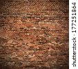 red brick wall texture grunge background with vignetted corners to interior design - stock photo
