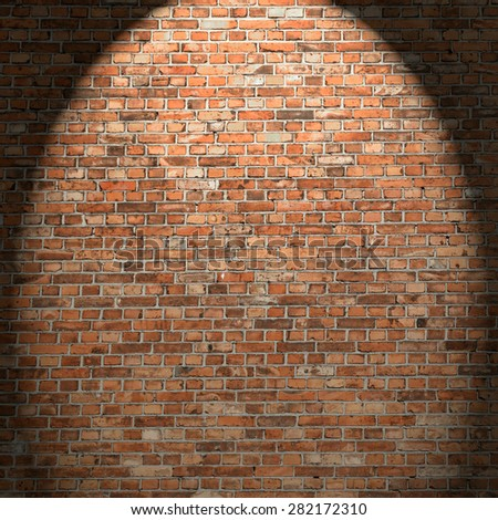 red brick wall texture, interior grunge background and beam of light