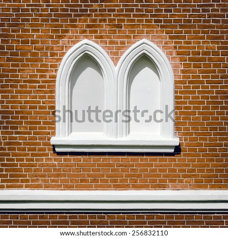 Red Brick Wall With Bricked-up Windows - stock photo