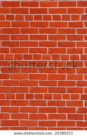 Red brick wall with light cement in between.