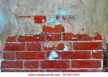Red brick wall with place for text. Half covered with cement wall.