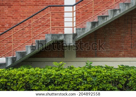 Red brick wall with stairs - stock photo
