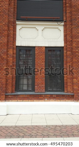 red brick wall with the window