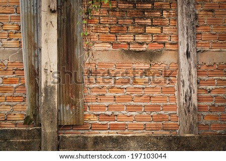 Red brick wall with  weathered cement  background