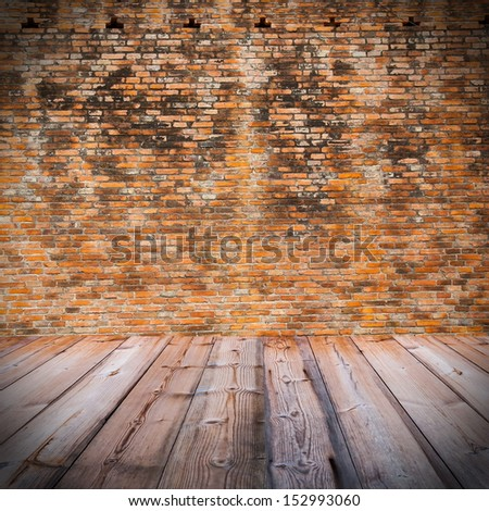 Red brick wall  with wooden floor - stock photo