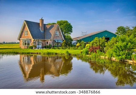 Red Bricks House In Countryside Near The Lake With Mirror Reflection In  Water, Amsterdam,