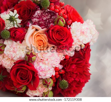 red bridal bouquet on the bokeh background