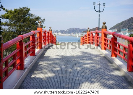 https://thumb1.shutterstock.com/display_pic_with_logo/167494286/1022247490/stock-photo-red-bridge-for-ocean-1022247490.jpg