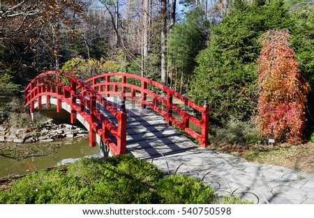 red bridge in a japanese tea garden on the campus of duke university