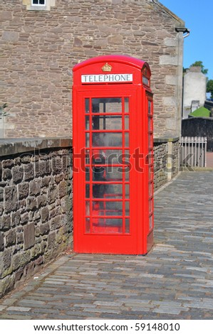 Red British telephone box in New Lanark - stock photo