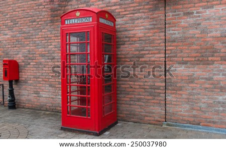 red British telephone box in UK - stock photo