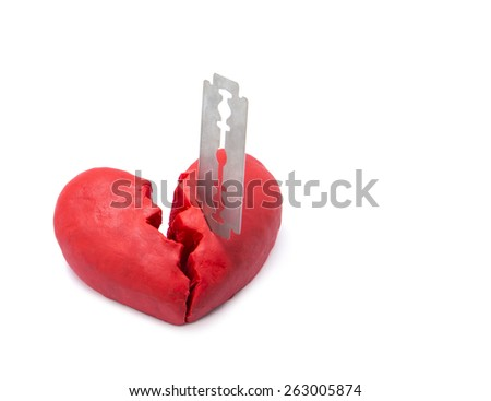 Red broken heart stab by razor isolate on white background. concept of broken relationship. - stock photo