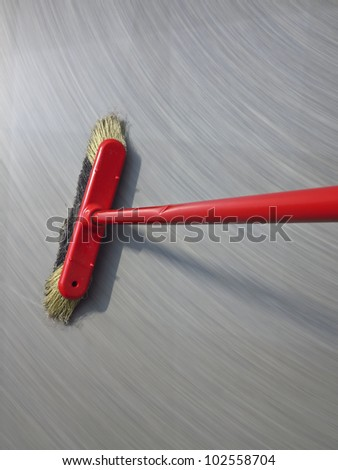 red broom sweeping  - long exposure time - stock photo